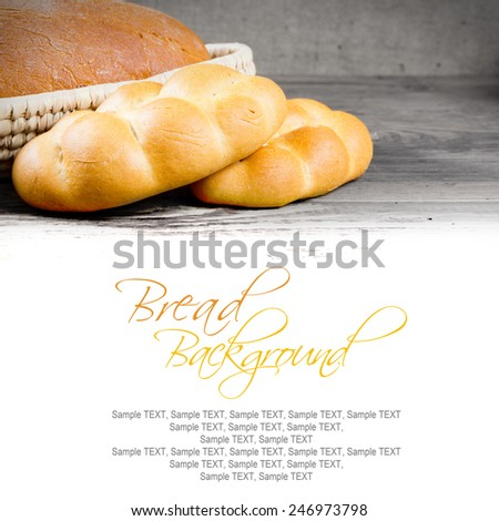 Bread with buns, seeds and slices on wooden background with white space for text