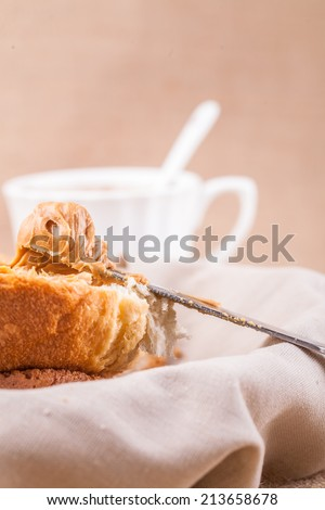 bread with butter on knife - stock photo