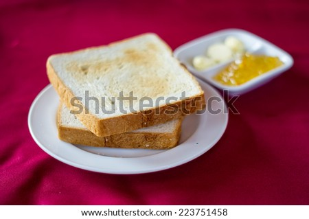 Bread with butter on the disk. - stock photo