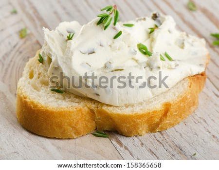 Bread with  cream cheese. Selective focus - stock photo