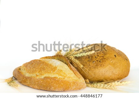 Bread with ears of wheat on a white background. not isolated