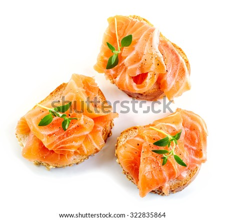 bread with fresh salmon fillet isolated on white background, top view - stock photo
