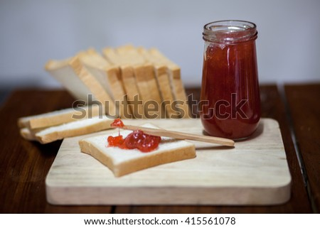 Bread with jam strawberry - stock photo