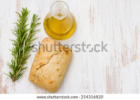 bread with oil and rosemary - stock photo