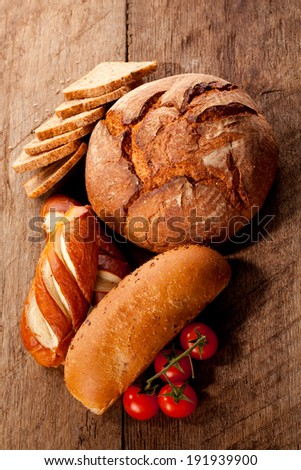 Bread with raw tomato on a table - stock photo
