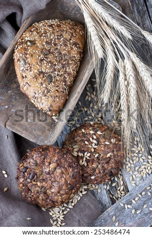 Bread  with rye on  old  wooden table - stock photo