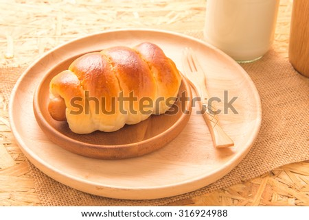 Bread with Sausage on wood plate - stock photo