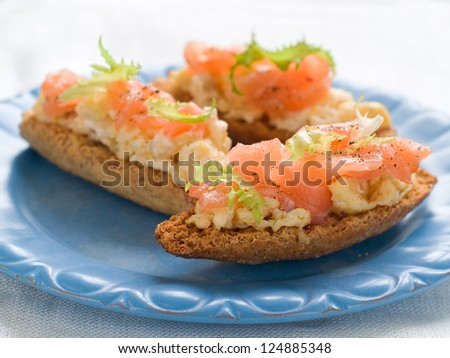 Bread with scrambled egg and salmon, selective focus - stock photo