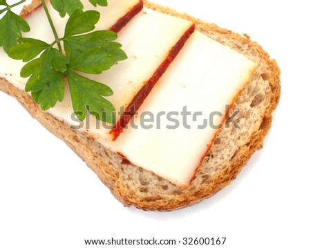 Bread with smoked salted pork fat and a piece of parsley