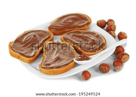 Bread with sweet chocolate hazelnut spread on plate isolated on white - stock photo