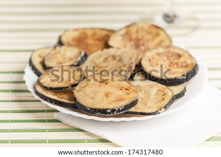 breaded and fried eggplant slices - stock photo
