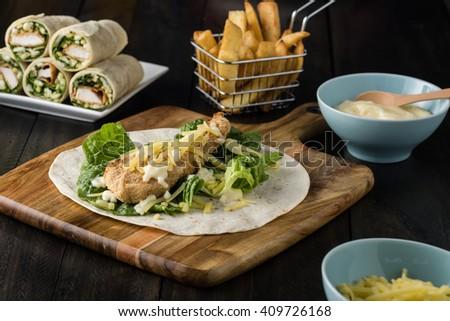 Breaded Chicken burrito Wrap With Fresh Lettuce Cheese  - stock photo