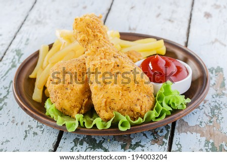 breaded chicken drumstick french fries leg