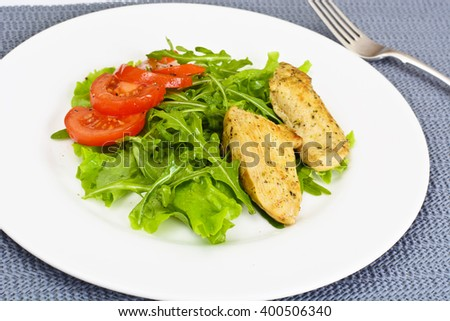 Breaded Chicken Fillet with Herbs. Studio Photo. - stock photo
