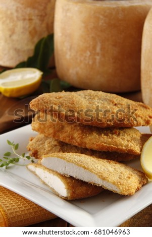 "breaded chicken with parmesan fillets recipe, spanish ""escalopes de pollo"" or ""milanesas de pollo"" with lemon slices"