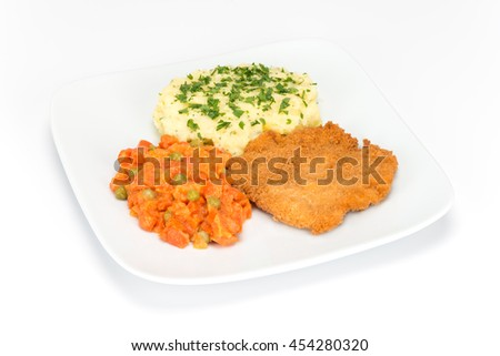 breaded fillet of chicken with potatoes and fried carrot on the plate isolated on white background - stock photo