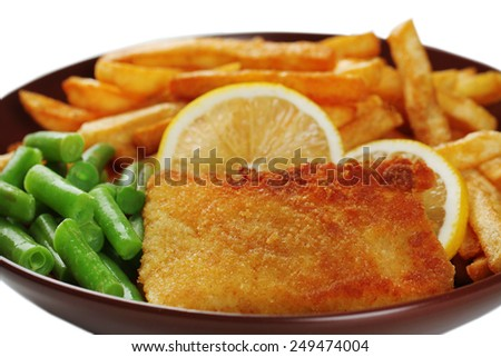 Breaded fried fillet and potatoes with asparagus and sliced lemon on white background - stock photo
