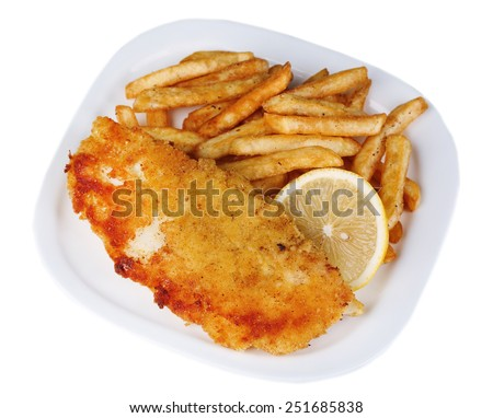 Breaded fried fish fillet and potatoes with sliced lemon on plate isolated on white - stock photo