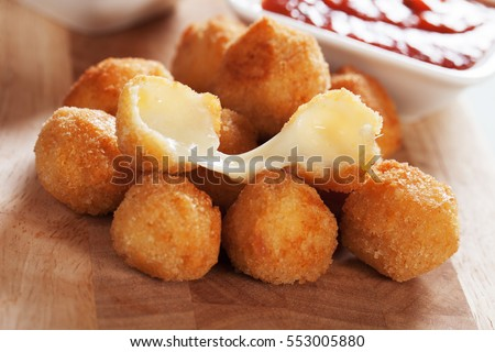Breaded mozzarella cheese balls with tomato sauce