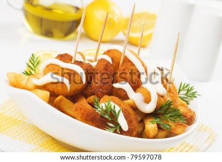 Breaded shrimp snack with french fries and mayonnaise - stock photo