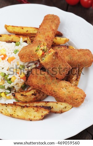 Breaded veggie sticks with cooked rice and roasted potato