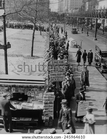 Breadline along Bryant Park in Mid-town Manhattan. A sign advertised meals for 1 cent and requests donations. New York City. 1930s. - stock photo