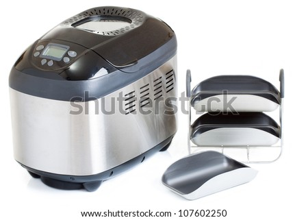 Breadmaker machine and accessories, isolated on a white background