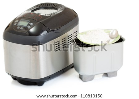 Breadmaker machine and accessories, isolated on white background