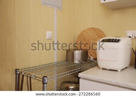 Breadmaker machine and pot - stock photo
