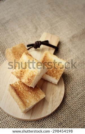 Breads in brown plate on wood background