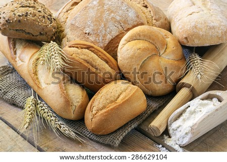 Breads on wood background - stock photo