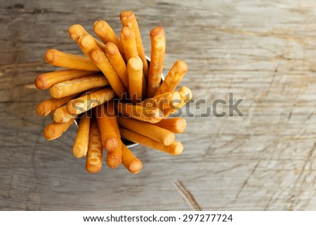 Breadsticks grissini on wooden background. Top view.  - stock photo