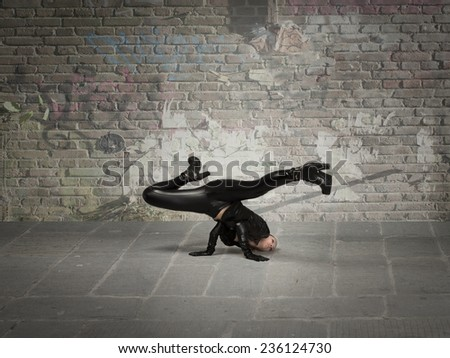 break dance movement for girl in leather cloth - stock photo