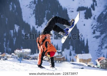 Break dance. Snowboarder, stunt. Tien Shan - stock photo