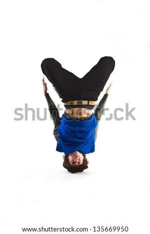 Break dancer rotating on head. - stock photo
