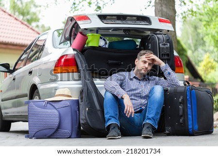 Break in packing stuff for a trip - stock photo