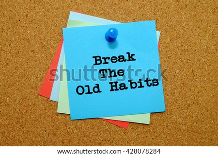Break the old habits written on colored sticker notes over cork board background. - stock photo