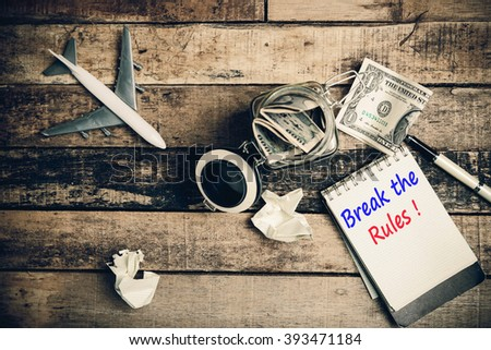 Break the Rules  word on pages. - stock photo