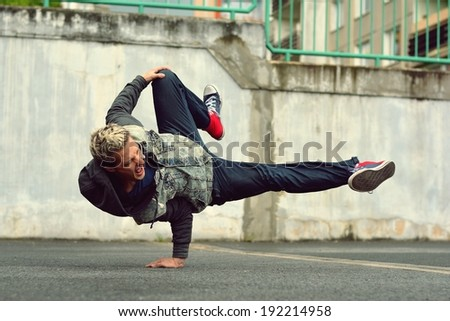 Breakdancer in the street - stock photo