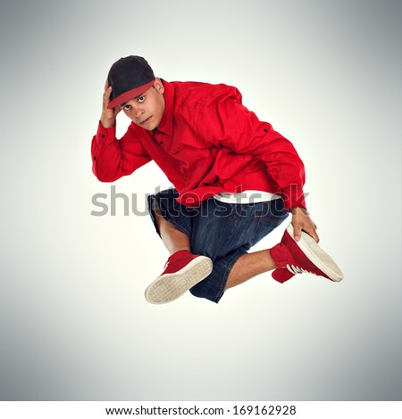 Breakdancer performer doing jump in studio