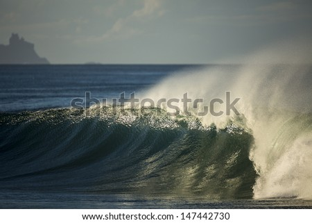 Breaker/ a wave peeling perfectly