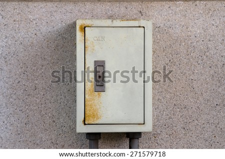 Breaker box on old dirty wall - stock photo