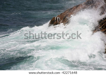 breakers in the Atlantic Ocean photographed in the summer during stormy weather at a wildcoast in Bretagne, France - stock photo