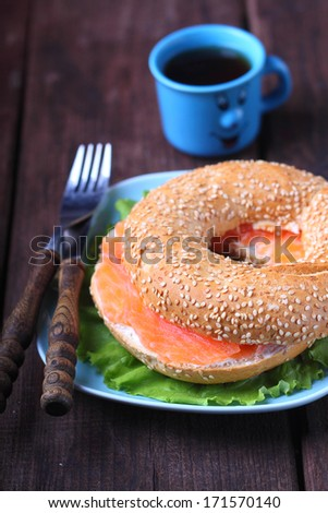 breakfast, a bagel with cream cheese and salmon - stock photo