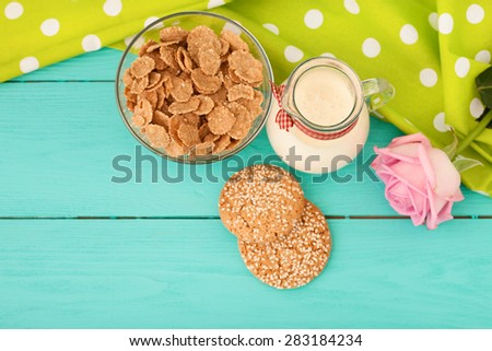 Breakfast and rose on blue wooden background. Selective focus - stock photo