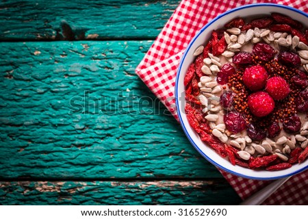 Breakfast banana smoothie bowl topped with goji berries,raspberry, sunflower and chia seeds. healthy food - stock photo