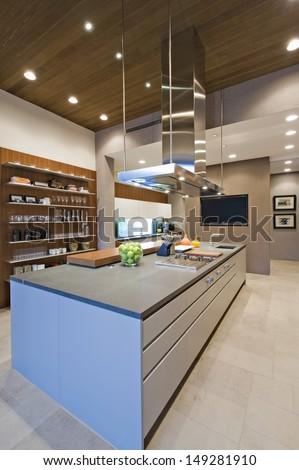 Breakfast bar in contemporary kitchen - stock photo
