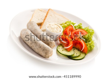 Breakfast - boiled white sausages, toasts and vegetables
