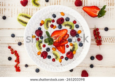 Breakfast bowl: coconut chia pudding with vanilla, fruits and berries. - stock photo