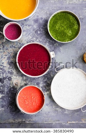 Breakfast bowl colorful collage. Superfoods and purple acai smoothie and yogurt recipe collection. Rustic style. - stock photo